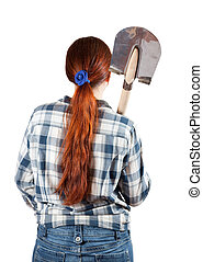rear view of woman with spade