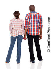 rear view of young afro american couple holding hands