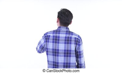 Rear view of young Asian hipster man touching something