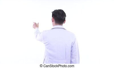 Rear view of young Asian man doctor touching something