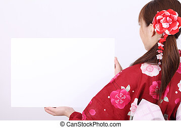 Rear view of young asian woman