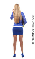 Rear view of young beautiful businesswoman, isolated on white