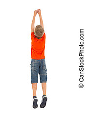 rear view of young boy jumping isolated on white background