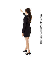 rear view of young business woman pointing