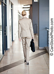 young businesswoman walking to office