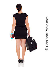 rear view of young female business traveler
