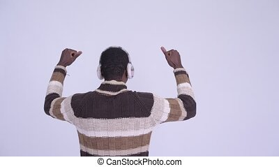 Rear view of young happy African man with fists raised ready...