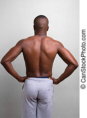 Rear view of young muscular African man shirtless