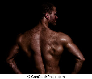 Rear view of young muscular man