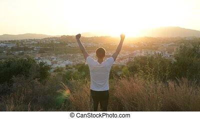 Rear View Of Young Tourist Man With Arms Raised While...