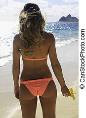 rear view of young woman in bikini