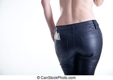 Rear view of young woman in leather pants