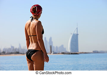 Rear view of young woman on Jumeira