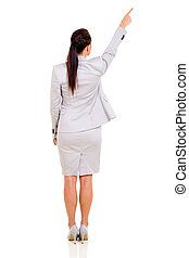 rear view of young woman pointing