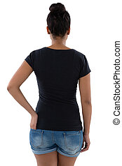 Rear view of young woman with hand in pocket