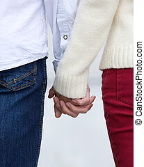 Rear view portrait of a young couple holding hands