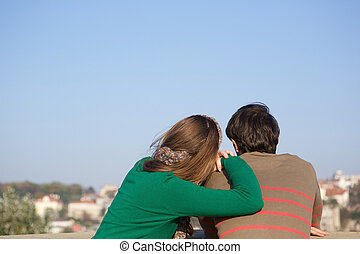 Rear view portrait of a young woman leaning on man's shoulder