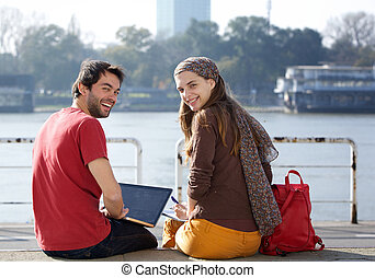 Rear view portrait of two college students smiling
