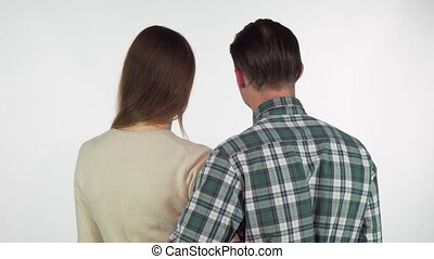 Rear view shot of a loving couple touching with their noses while hugging