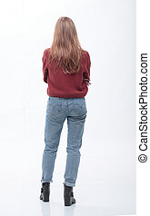rear view. student girl standing in front of white blank screen