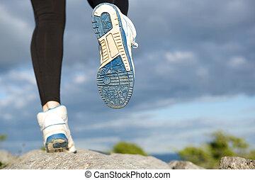Rear view woman running outdoors