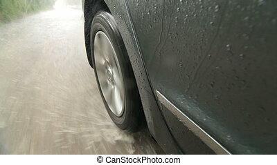 Rear wheel of car splash water at high speed in flood city road