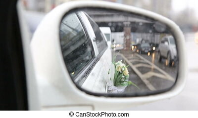 Rearview mirror of a wedding limousine - Raindrops on the...