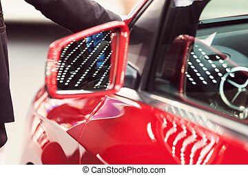 rearview mirror on the motor vehicle, note shallow depth of ...