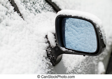 Rearview mirror - Photo of a snowy rearview mirror at winter
