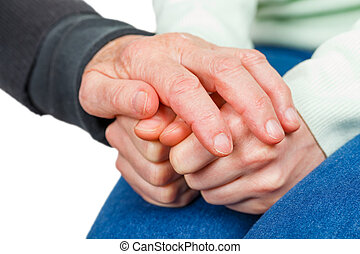 Reassuring hands - Wrinkled reassuring hand on young anxious...