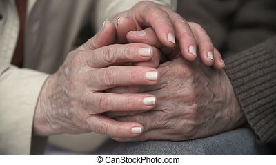 Reassuring Touch - Extreme close up of female hands touching...