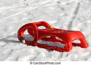 reb sled for playing in the snow in mountains in winter