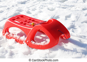 reb sled for playing in the snow in winter - reb sled in the...
