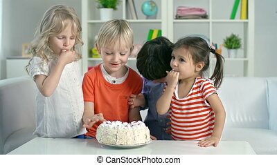 Rebel Day - Four kids eating birthday cake with their hands