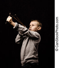 Rebellion - Little boy shooting with a slingshot