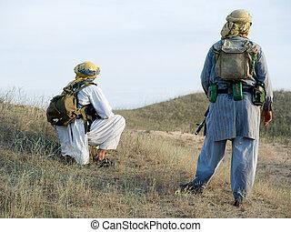 rebels  - Muslim rebels with rifles