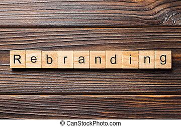 rebranding word written on wood block. rebranding text on table, concept