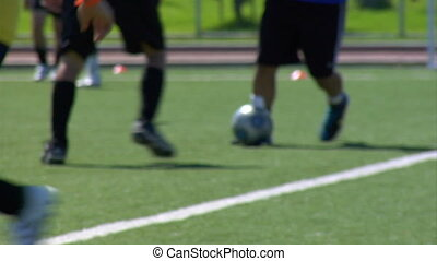 Close up shot of people playing soccer (football)