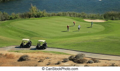 REC-0055 golfers on green