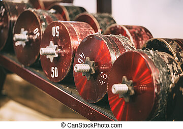 Receding row of weights lined up in a gym