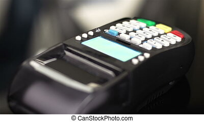 Receipt - Shop assistant inserting a credit card into a pos...