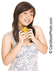 Received a Gift - A pretty young asian woman smiles as she ...