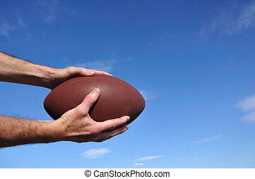 Receiver Catching an American Football Pass