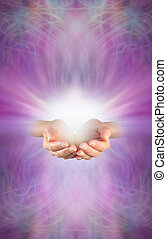 Receiving a Reiki Attunement - Female cupped hands with...