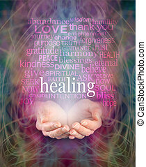 Female cupped hands with the word 'healing' floating above surrounded by a word cloud of healing related words on a swirling misty energy background