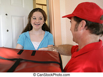 Receiving Pizza Delivery - A teen girl receiving a pizza...