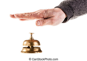Reception - a mature old man ringing a hoted reception bell ...