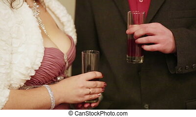Reception - Man and woman holding glasses of champagne at a...