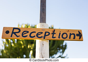 Reception sign at a hotel.