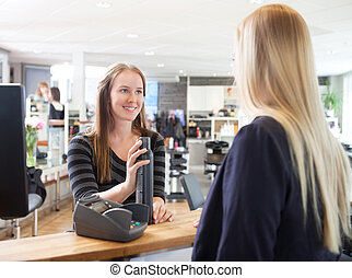 Receptionist and Client in Beauty Salon - Receptionist and...